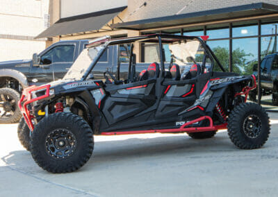 black and red polaris rzr outside